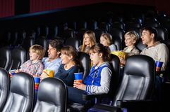 Shocked Families Watching Movie Royalty Free Stock Photos