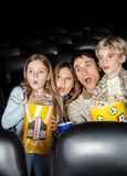 Shocked Family Watching Film In Theater Stock Photos