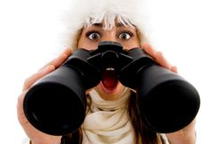 Shocked female with binocular Stock Images