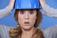 Shocked female builder Royalty Free Stock Photo