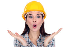 Shocked female construction worker. Doesn't know what to do Royalty Free Stock Image