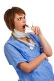 Shocked female doctor holding filled syringe Royalty Free Stock Photos