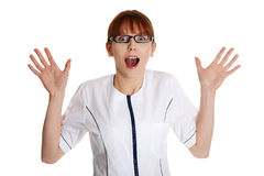 Shocked female doctor or nurse Stock Photography