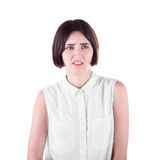 A shocked female isolated on a white background. An attractive office lady is shocked and disappointed. Face expressions concept. stock image