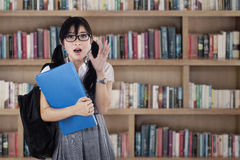 Shocked female student at library Stock Image