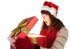 Shocked festive brunette opening a gift Royalty Free Stock Image