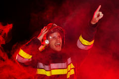 Shocked firefighter in action Stock Images
