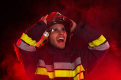 Shocked firefighter in action Royalty Free Stock Images
