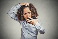 Shocked funny looking young woman, surprised she is losing hair Royalty Free Stock Images