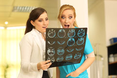 Shocked funny two beautiful female doctors Stock Photos