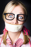 Face Of Nerdy Geek Gobsmacked By Silence. Shocked Geeky Nerd Traumatised During A Hostage Siege Whilst Being Kept Quiet With Taped Mouth Stock Photography