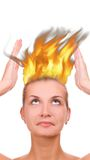 Shocked girl. Picture of a Shocked girl with a fire coming out her head Royalty Free Stock Photography
