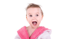 Shocked girl. Portrait of a  young shocked girl in bathrobe Royalty Free Stock Photography