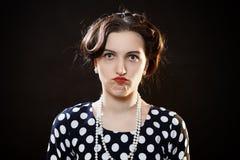 Shocked girl on black Royalty Free Stock Photos