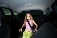 Shocked girl in car. Child in car. Shocked girl. Accident Royalty Free Stock Photography