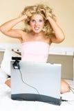 Shocked girl communicating using a web camera Stock Image