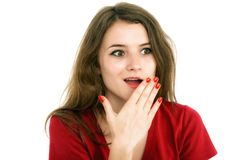 Shocked girl covers her mouth with hands. Isolated on white Stock Image