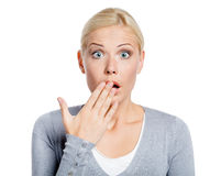 Shocked girl covers her mouth with hand. Shocked girl covers her opened mouth with hand, isolated on white Royalty Free Stock Image