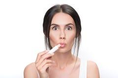 Shocked girl doing healthy facial make-up Stock Image