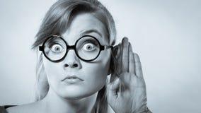 Shocked girl eavesdropping. Stock Images