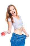 Shocked girl is happy with the result of an apple diet on a whit Stock Photos
