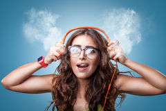 Shocked girl in headphones listening to music. Stock Photo