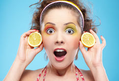 Shocked girl with lemon Royalty Free Stock Photo