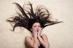 Shocked girl with long hair Stock Photography