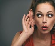 Shocked girl overhearing someone stock images