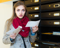 Shocked girl standing with letter Stock Photography
