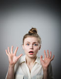Shocked girl. A girl taken aback by something. Young slim woman Stock Photos