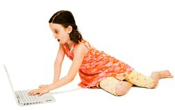 Shocked girl using a laptop Royalty Free Stock Images