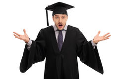 Shocked graduate student gesturing with his hands Royalty Free Stock Photography