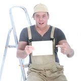 Shocked handyman with blank sign Royalty Free Stock Photo