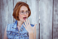 Shocked hipster woman looking away from the camera Stock Photos