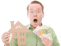 Shocked houseowner with money Royalty Free Stock Photo