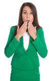 Shocked isolated business woman in green dress. Shocked isolated business woman wearing green dress Royalty Free Stock Photo