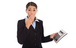 Shocked isolated businesswoman looking frustrated at pocket calc Royalty Free Stock Photography