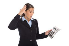 Shocked isolated businesswoman looking frustrated at pocket calc Royalty Free Stock Image