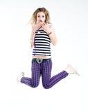 Shocked jumping girl stock image