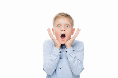Shocked kid. Portrait of shocked caucasian little boy looking at camera isolated on white Stock Photos