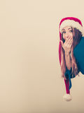 Shocked lady behind the corner. Royalty Free Stock Photography
