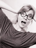 Shocked lady expressing awe. Feelings tension astonishment adrenaline concept.S hocked lady expressing awe. Young girl in glasses holding her face showing Royalty Free Stock Photo