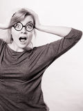 Shocked lady expressing awe. Feelings tension astonishment adrenaline concept.S hocked lady expressing awe. Young girl in glasses holding her face showing Stock Image