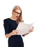 Shocked lady reading womens magazine Royalty Free Stock Photography