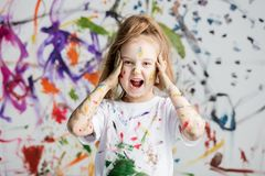 Shocked little girl grabbing her head. Looking surprised. Messy fun. Shocking discovery Royalty Free Stock Photo