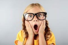 Shocked little girl on grey stock images