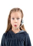 Shocked little girl with headset. Royalty Free Stock Photo