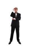 Shocked looking man wearing a tuxedo and sunglasses Stock Image