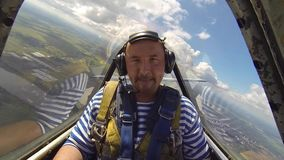 Shocked man in aerobatic aircraft in the sky stock video footage
